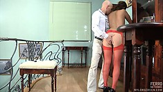 Lusty Megan in sexy red stockings bends over to take in a cum gun