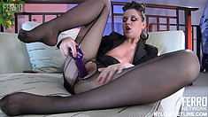 Smoking hot brunette shows off her stockings while fucking herself