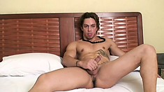 Hot stud with a ripped body Santiago lies on the bed pleasing himself